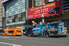 New York City Sightseeing Buses. Two sightseeing buses on Eighth Avenue, in Manhattan royalty free stock images