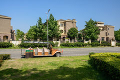 Sightseeing car on asphalted road in sunny summer Stock Image