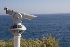 Sightseeing coin operated telescope. On the cliffs used for looking out into the sea in Carvoeiro, Algarve, Portugal. Wording on the telescope is instructions Stock Image