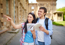Sightseeing. Couple of travelers with map sightseeing in ancient town Stock Images