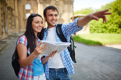 Sightseeing. Couple of travelers with map sightseeing in ancient town Royalty Free Stock Image