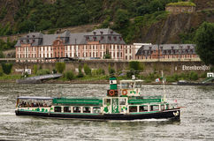 Sightseeing Cruise, Koblenz. Sightseeing Cruise on the Rhine in Koblenz, Germany and in the background the train station Ehrenbreitstein Stock Images