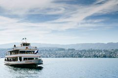 Sightseeing cruise ship and peaceful lake Zurich scenery royalty free stock photography