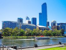 Sightseeing ferry in Yarra river with beautiful cityscape view of Melbourne CBD in sunny day. MELBOURNE, AUSTRALIA. – On December 29, 2013 - Sightseeing stock photography