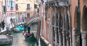 Sightseeing on gondolas in Venice, Iltaly stock video