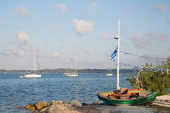 Sightseeing in Greece: traditional fishing boats on the greek is Stock Images
