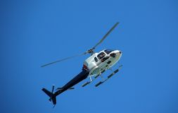 Sightseeing helicopter. View from the ground of helicopter flying overhead royalty free stock photos