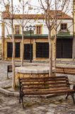 Sightseeing in Korca, Albania, Ottoman Old Bazaar. Quiet  corner with a wooden bench and the view to Ottoman Old Bazaar architecture in Korca, Albania Stock Photography