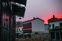 Sightseeing in Korca, Ottoman Old Bazaar by. One of the sights of Korca, Albania, ottoman Old Bazaar  captured in the evening with red and blue sunset sky Stock Photo