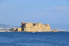Castel dell`Ovo on a peninsula on the gulf of Naples in Italy royalty free stock image