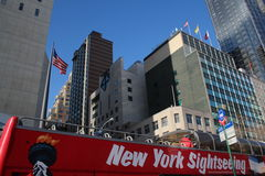 Sightseeing in New York. Typical red sight seeing Bus in front of the skyline of the big apple Stock Image