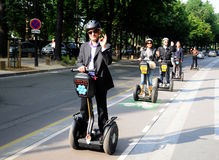 Sightseeing   in Paris Gyropode Segway. Unusual mode of transport in the city - Paris Royalty Free Stock Images