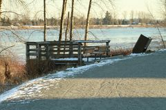 A sightseeing platform off the edge of a trail. With a river in the background on a winter day Stock Photo