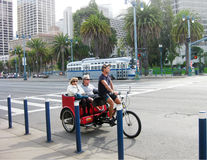 Sightseeing with rickshaw on the street of San Francisco Stock Photography