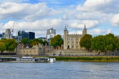 River boat on the river thames. A sightseeing river boat sailing by the tower of London on the thames river in London England UK stock image