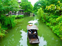 Sightseeing sculling boats rowing on a river. Fishermen rowing oar propelled boat on a river inside Xixi Wetland Park Hangzhou China Stock Images