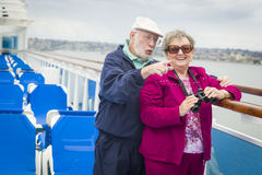 Sightseeing Senior Couple on The Deck of a Cruise Ship Stock Image