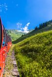 Sightseeing by the steam train in swiss alps Royalty Free Stock Photos