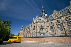Sightseeing Stockholm. Nordic Museum (Nordiska Museet) in Stockholm, Sweden, yellow sightseeing bus Stock Photography