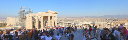 Sightseeing of Temple of Athena Nike. ATHENS, GREECE - OCTOBER 6: Tourists sightseeing the ruins of the Temple of Athena Nike in the Acropolis of Athens on Stock Photo