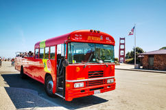 Sightseeing tour bus at the Golden Gate bridge in San Francisco Royalty Free Stock Photography