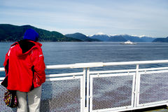 BC ferries pleasure summer. BC Ferries  pleasure summer trip en-route to Vancouver Island Canada with the Canadian Rockies in the background Stock Photo