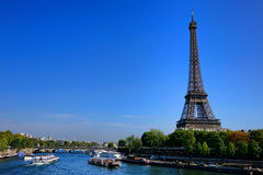 Sightseeing Tourist Boat Traffic on Seine in Paris Stock Photo