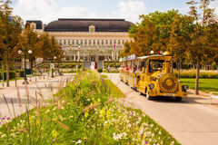Sightseeing train drives tourists through the park in front of Stock Image