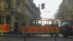 Sightseeing tram rides through the streets stock footage