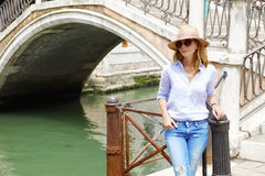 Sightseeing in Venice. Portrait of a smiling woman standing in old city while on sightseeing tour Stock Photography