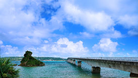 Sightseeing View of The Kouri Bridge. With blue sky, one of the very long bridge in Okinawa Japan Royalty Free Stock Photo