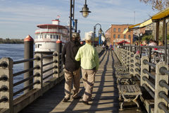 Sightseeing on the Water Street Boardwalk in Wilmington, NC Stock Photo
