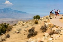 Sightseers enjoy the view at Keys View, overlooking the Coachella Valley at Joshua Tree National Park, California. Twentynine Palms, CA - Sightseers wave an royalty free stock images