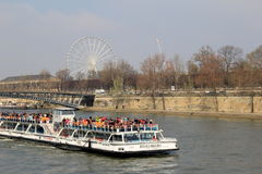 Sightseers enjoying a day along The Seine,Bati Aux - Mouches,Paris, France,2016. Crowd of sightseers enjoying a warm Spring day on The Seine, Boating with Bati Royalty Free Stock Image