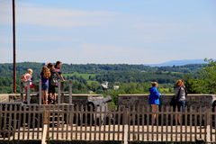 Sightseers standing near old stone walls, looking over battlefields,Fort Ticonderoga,New York,2015 Stock Photos