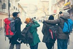 Sightstad för fyra turister Arkivfoto