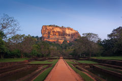 Sigiriya. Lion's rock and gardens at sunset, with ancient ruins Stock Photography