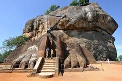 Sigiriya Lion stairs. Tourist climb the lion stairs of the sigiriya rock Stock Photo