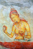 Sigiriya maiden - frescoes at fortress in Sri Lanka Royalty Free Stock Photo