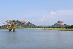 Sigiriya and Pidurungala Rock in Sri Lanka. Human made tank, Pidurungala rock and Sigiriya Lion Rock Fortress in Sri Lanka, so-called 8th wonder of the world and Stock Photo