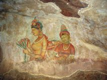 Sigiriya princesses. Cave painting. The frescos representing a procession of princesses, covered by structure from an egg white with honey of wild bees, have Stock Image