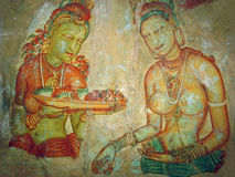 Sigiriya princesses. Cave painting. The frescos representing a procession of princesses, covered by structure from an egg white with honey of wild bees, have Stock Photos