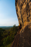 Sigiriya Rock Cliff Face Stairs Exit Landscape. The steps leading away from the cliff face exit of Lions Rock and the beautiful surrounding rural landscape in royalty free stock images
