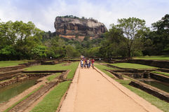 Sigiriya Rock Fortress. Tourists at Sigiriya rock fortress, Sigiriya is famous tourist landmark, UNESCO listed World Heritage Site. SIGIRIYA, SRI LANKA - 4 Stock Images