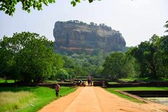 Sigiriya Rock or Lion Rock is an ancient fortress near Dambulla, Sri Lanka. Sigiriya is a UNESCO World Heritage Site. Sigiriya Rock or Lion Rock , Sri Lanka Stock Photography