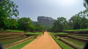 Sigiriya Rock or Lion Rock is an ancient fortress near Dambulla, Sri Lanka. Sigiriya is a UNESCO World Heritage Site. Sigiriya Rock or Lion Rock , Sri Lanka Royalty Free Stock Photography