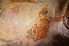 World famous frescoes of Sigiri Damsels, called Sigiri Apsaras, Sigiriya, Sri Lanka Royalty Free Stock Images
