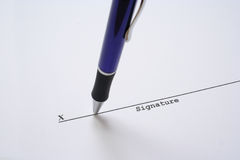 Sign on the X 1. Blue pen on signature line Royalty Free Stock Photography