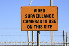 Sign. An orange warning sign, Video Surveillance Cameras in use on this site Stock Image