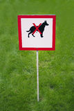Sign. Lawn with a sign prohibiting dogs roam Stock Images
